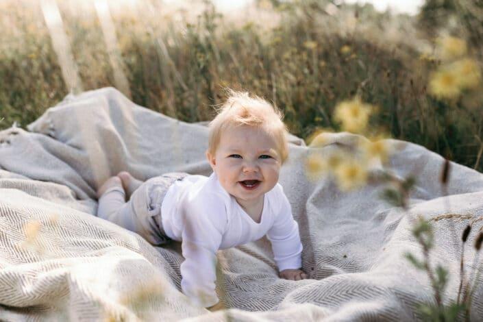 Baby boy smiling on the grass   Motherhood session   Family photography in Basingstoke   Hampshire   Ewa Jones Photography