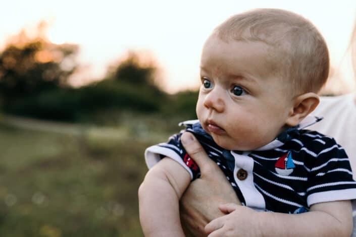 Little boy is looking away. Golden hour photo session in Basingstoke. Ewa Jones Photography