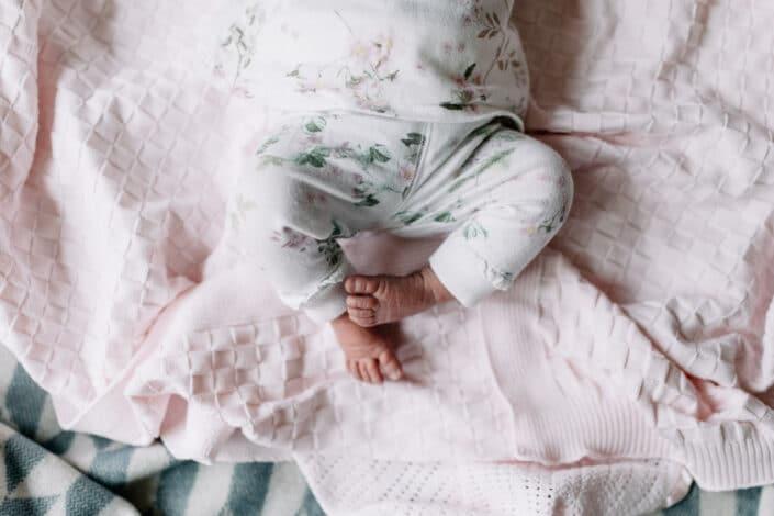 Close up detail of newborn baby feet. Newborn baby photo session in Basingstoke, Hampshire. Ewa Jones photography