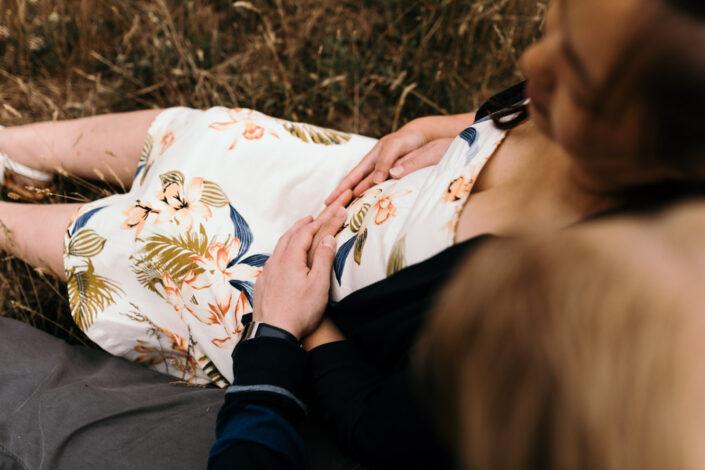 Both parents are holding bump. Maternity photography. Ewa Jones Photography