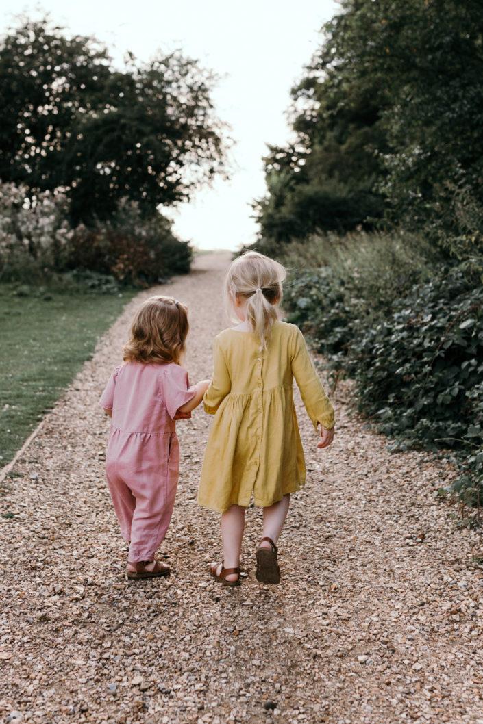 Sisters holding hands. Sunset family photoshoot in Basingstoke. Ewa Jones Photography