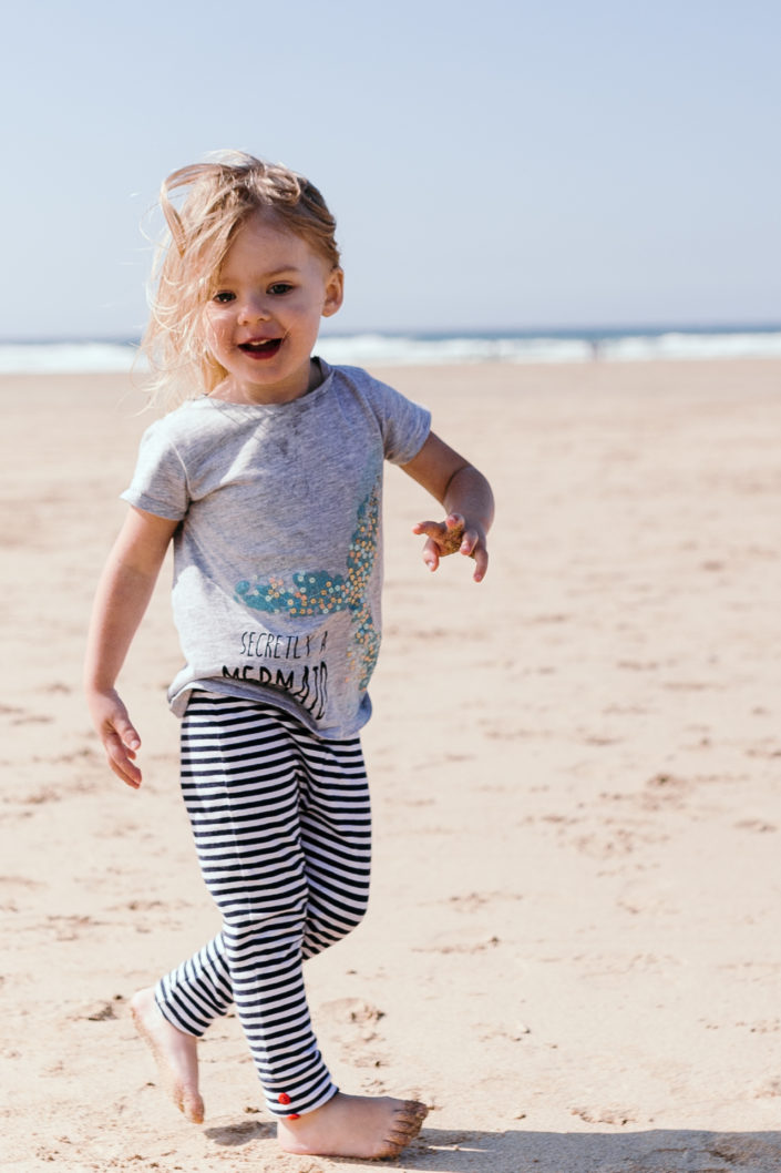 Girl playing on the beach by Ewa Jones Photography | Basingstoke Photography