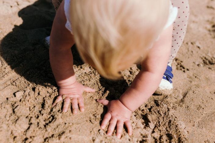 Girl playing with sand by Ewa Jones Photography | Basingstoke Photography
