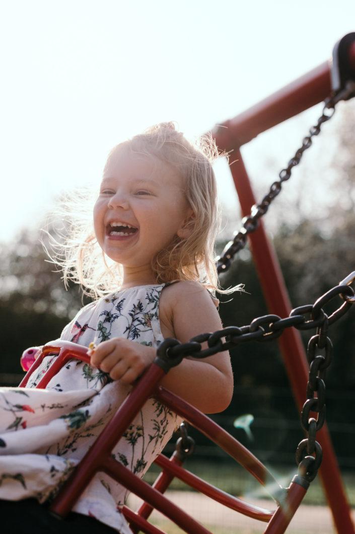 Happy girl on the swing by Ewa Jones Photography