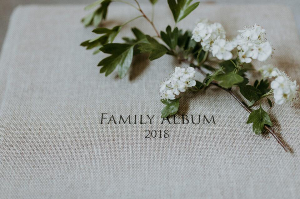 Photo album with a family album 2018 writing. Photo album in light textile colour. Ewa Jones Photography