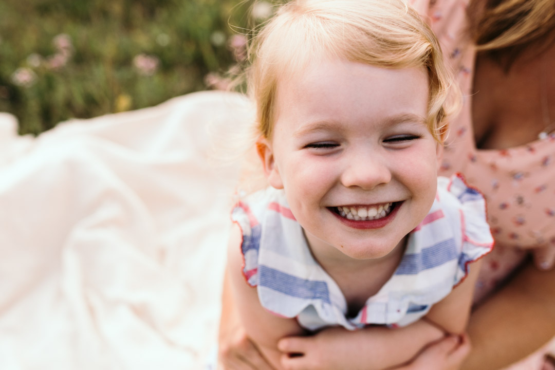 Little girl is laughing to the camera. Family photography in Hampshire. Ewa Jones Photography