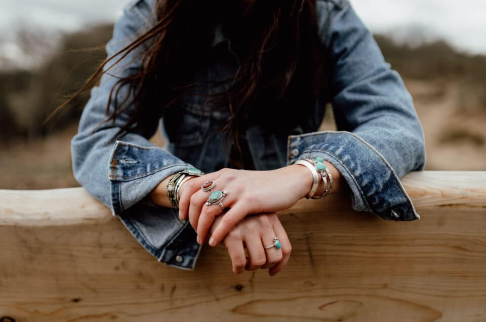 Product photography with Rusticrafts. Close up of girls hands resting on the bench. She is wearing lovely hand made jewellery. Products photography in Hampshire. Ewa Jones Photography