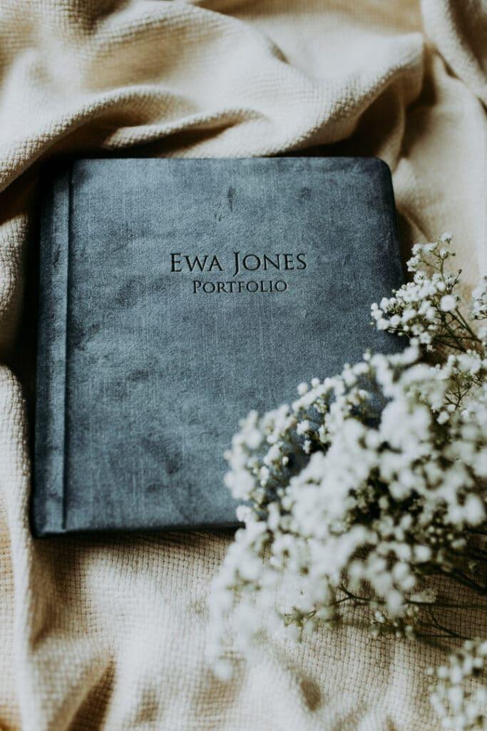 Family photo album in blue colour on light background. Family photographer in Basingstoke. Ewa Jones Photography