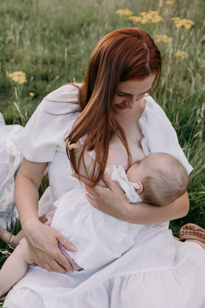 Mum is breastfeeding her little baby girl. Lovely candid photograph of mum and her baby. World breastfeeding week. Breastfeeding photo session in Basingstoke, Hampshire. Family photographer in Basingstoke, Ewa Jones Photography