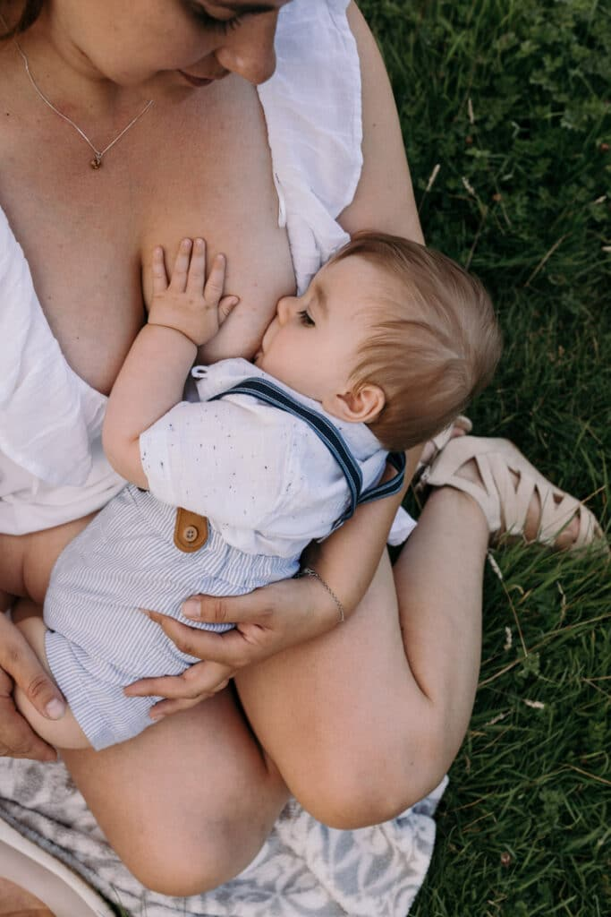 Mum is breastfeeding her little baby boy. Lovely candid photograph of mum and her baby. World breastfeeding week. Breastfeeding photo session in Basingstoke, Hampshire. Family photographer in Basingstoke, Ewa Jones Photography