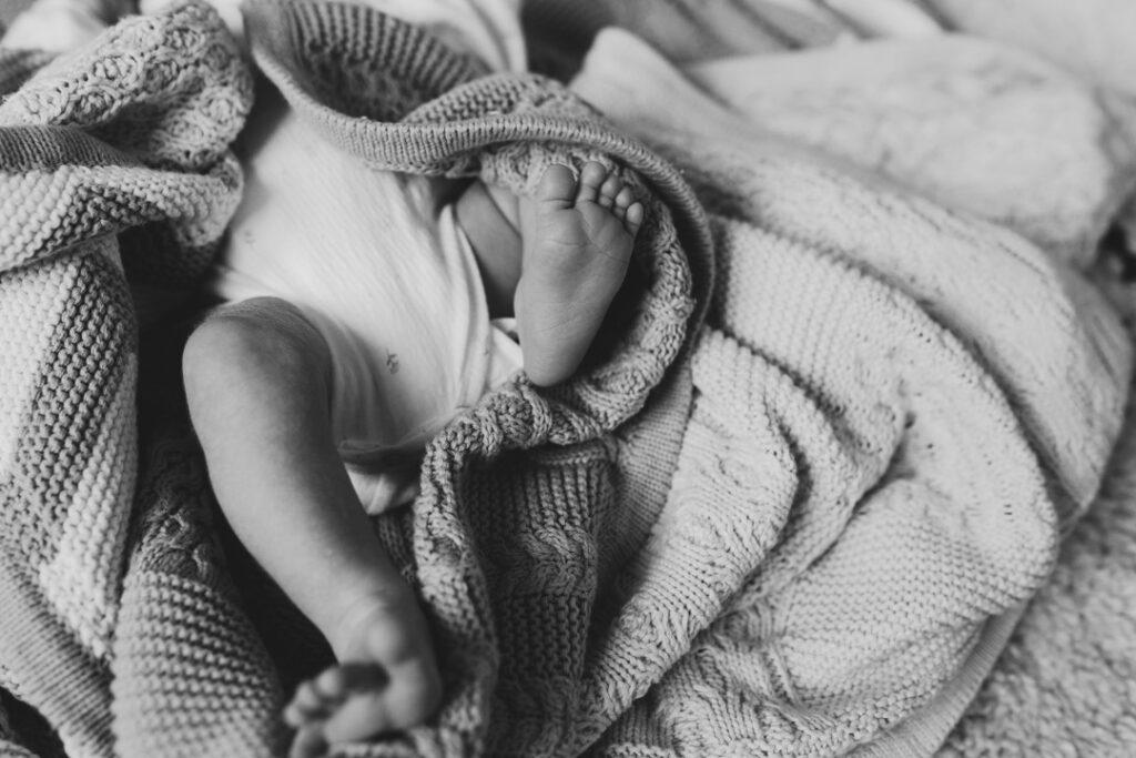 Black and white photograph of newborn baby feet. newborn photographer in Hampshire. Ewa Jones Photography